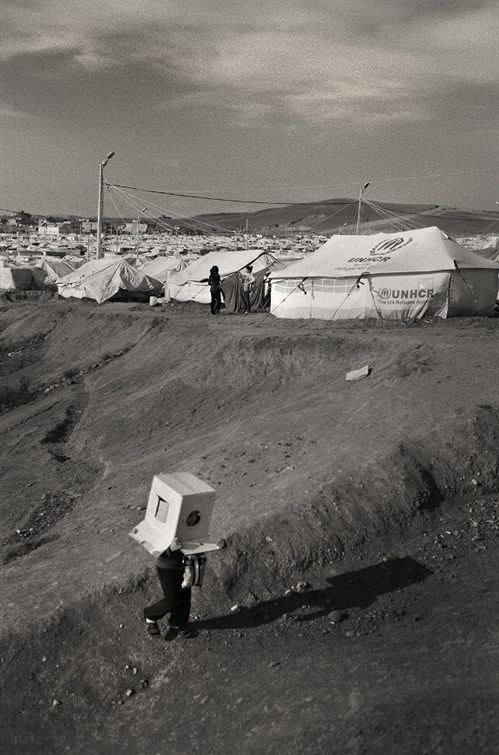 A Child Plays In Kawergosh Refugee Camp 599X907
